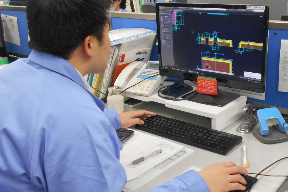 A saff member working on a computer.